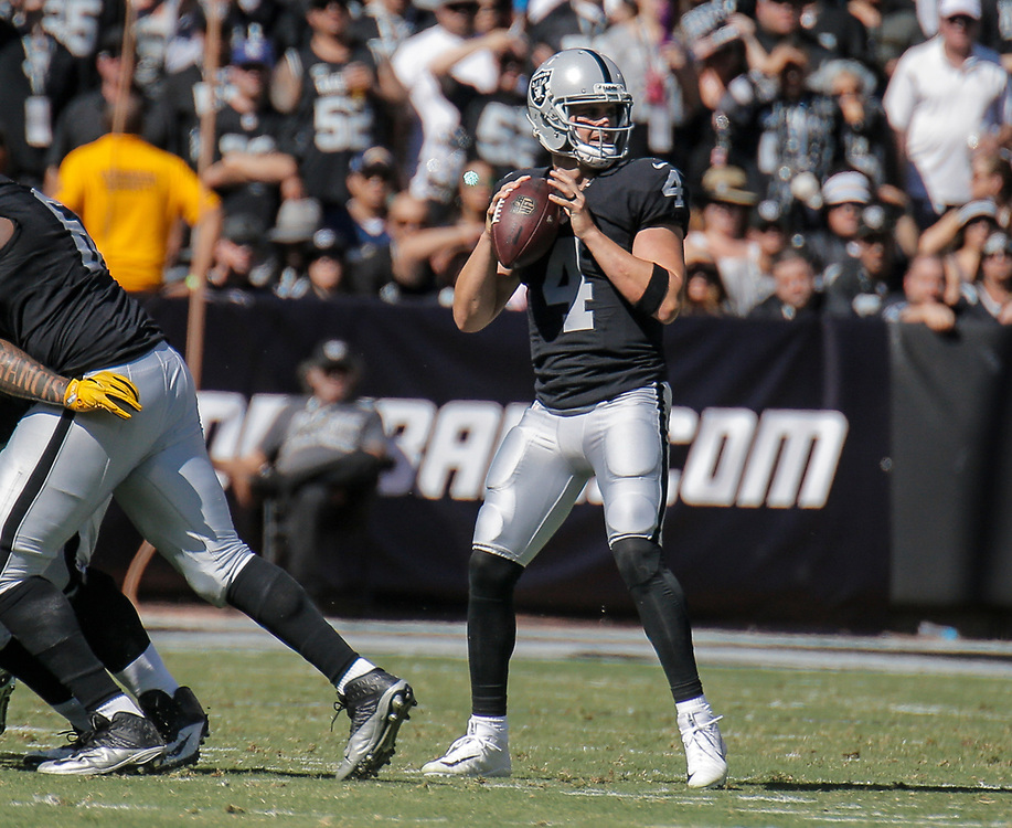 Oct 09 2016 - Oakland U.S. CA -Raiders quarterback Derek Carr #4 game stats comp 25/ att 40 for 317 yards, 2 tds, 1 int and was sacked 3 times during the NFL Football game between San Diego Chargers and the Oakland Raiders 34-31 win at O.co Coliseum Stadium Oakland Calif. Thurman James