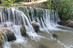 Waterfall into Block Creek, swollen by recent rains, Block Creek Natural Area, Hill Country, Texas, USA