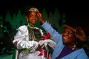 A young winner at a beauty talent contest in the gym at the Bedford-King Recreation Center in Atlanta, Georgia. The black community hold annual events here including sports competitions and occasions such this pageant where the girls and also boys prove their talents and potential.