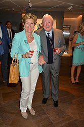 SIR DONALD GOSLING and GABRIELLA DI NORA at a private view of paintings by Michael Flatley entitled Firedance held at 12 hay Hill, London on 24th June 2015.