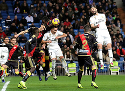 MADRID, Dec. 16, 2018  Real Madrid's Lucas Vazquez (3rd R) heads for the ball during a Spanish league match between Real Madrid and Rayo Vallecano in Madrid, Spain, on December 15, 2018. Real Madrid won 1-0. (Credit Image: © Edward F. Peters/Xinhua via ZUMA Wire)