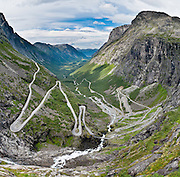 Trollstigen (the Troll's Ladder) is a steep (9% grade) mountain road with eleven hairpin turns in Rauma, Norway, part of Norwegian National Road 63 connecting Åndalsnes in Rauma and Valldal in Norddal. Surrounding the road is Reinheimen National Park, Norway's third largest. Trollstigen was opened 1936 by King Haakon VII after 8 years of construction. See impressive Stigfossen waterfall tumble 320 meters as you zig zag up or down this popular, mostly single-lane tourist road. Panorama stitched from 10 overlapping photos.