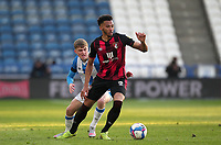 Huddersfield Town's Scott High in action with  Bournemouth's Lloyd Kelly<br /> <br /> Photographer Mick Walker/CameraSport<br /> <br /> The EFL Sky Bet Championship - Huddersfield Town v Bournemouth - Tuesday 13 April 2021 - The John Smith's Stadium - Huddersfield<br /> <br /> World Copyright © 2020 CameraSport. All rights reserved. 43 Linden Ave. Countesthorpe. Leicester. England. LE8 5PG - Tel: +44 (0) 116 277 4147 - admin@camerasport.com - www.camerasport.com
