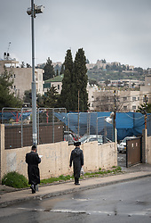 29 February 2020, Jerusalem: A pair of Jewish men walk in the neighbourhood of Sheikh Jarrah in East Jerusalem. While a predominantly Palestinian neighbourhood, Sheikh Jarrah is under constant pressure from Israeli settler movements looking to push Palestinian families out and take over the area.