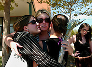 Kristen Adkins, left; Abby Lacheur, center;  Jamie Pember, right, friends of Meagan Hadley, Carmel Lea and Kristina Blake support each other outside the Trinity  Life Center where a memorial service was held Thursday, August 11, 2004.  The trio were killed in an early morning auto accident on I-80 near Penryn, Sunday, August 8, 2004 when they were returning from Reno, NV.
