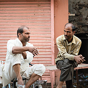 Two Indian men in conversation in old town of Jaipur