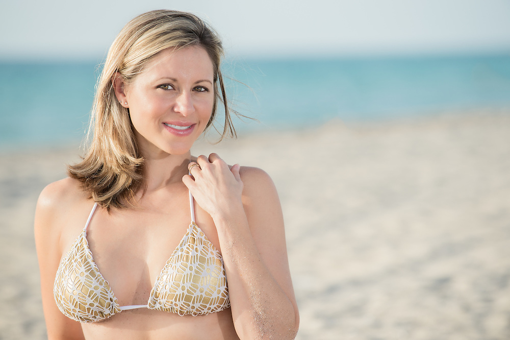 Portrait of woman smiling and very happy in the beach with room for copy,