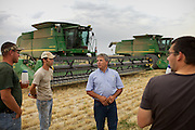 "Seasonal workers having lunch in the field...Life of custom harvesters: custom harvesting or custom combining is the business of harvesting of crops for others. Custom harvesters usually own their own combines and work for the same farms every harvest season. Custom harvesting relieves farmers from having to invest capital in expensive equipment while at the same time maximizing the machinery's use. .Harvesters travel North to South through the US, living in trailers, following the season, usually hiring overseas seasonal workers in need of improving their harvesting experience on very large combines (harvesting machines)...A 4-weeks road trip across the USA, from New York to San Francisco, on the steps of Jack Kerouac's famous book ""On the Road"".  Focusing on nomadic America: people that live on the move across the US, out of ideology or for work reasons."