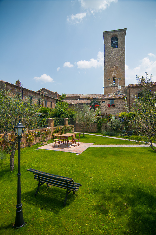 """A garden of a house of the village of Civita di Bagnoregio.<br /> Civita di Bagnoregio is a town in the Province of Viterbo in central Italy, a suburb of the comune of Bagnoregio, 1 kilometre (0.6 mi) east from it. It is about 120 kilometres (75 mi) north of Rome. Civita was founded by Etruscans more than 2,500 years ago. Bagnoregio continues as a small but prosperous town, while Civita became known in Italian as La città che muore (""""The Dying Town""""). Civita has only recently been experiencing a tourist revival. The population today varies from about 7 people in winter to more than 100 in summer.The town was placed on the World Monuments Fund's 2006 Watch List of the 100 Most Endangered Sites, because of threats it faces from erosion and unregulated tourism."""