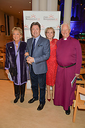 Left to right, FLAPPY LANE FOX, ALAN TITCHMARSH, JULIA SAMUEL and the Rt.REV.SANDY MILLAR at the charity Child Bereavement UK's 21st Anniversary Christmas Carol Concert held at Holy Trinity Brompton, London on 10th December 2015.