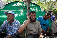 Ibrahim Ali, a member of the Muslim Brotherhood, sitting in a temporary camp supporting arrested president Morsi.