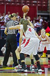 03 January 2014:  Referee Lisa Mattingly prepares for the jump ball to begin the game during an NCAA women's basketball game between the Drake Bulldogs and the Illinois Sate Redbirds at Redbird Arena in Normal IL