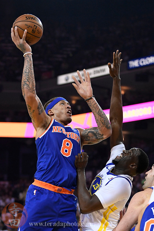 January 23, 2018; Oakland, CA, USA; New York Knicks forward Michael Beasley (8) shoots the basketball against Golden State Warriors forward Draymond Green (23) during the first quarter at Oracle Arena.