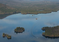 It was a bright blue Friday for Phil DiVirgilio as he takes flight over Squam Lake in his WACO biplane.
