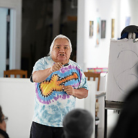 On Tuesday, Arnulfo Peña, 72, shares with guests his passion for painting at the Art123 Gallery in Gallup.