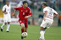 FOOTBALL - CONFEDERATIONS CUP 2003 - GROUP B - TYRKIA v USA - 030619 - ERGUN PENBE (TUR) / CLINT MATHIS (USA) - PHOTO STEPHANE MANTEY / DIGITALSPORT