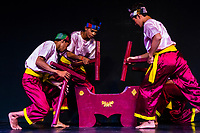 Kdoeurng Mortar Dance (Robam Tbal Kdoeurng), a folk dance featuring the Tbal Kdoeurng, a traditional mortar used to husk rice or make flour. Traditional dance show presented by Cambodian Living Arts, National Museum of Cambodia, Phnom Penh, Cambodia.