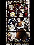 Church of Saint Mary, Gosbeck, Suffolk, England, UK stained glass window birth of Jesus Christ