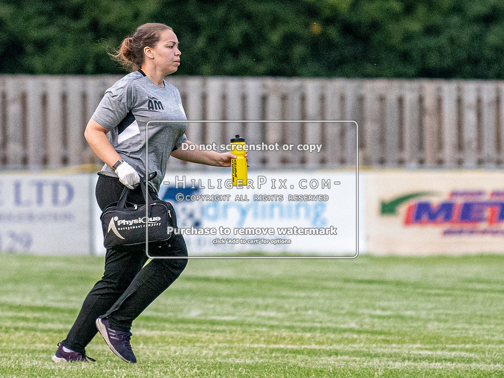 DARTFORD, UK - AUGUST 01: Ally Maloney, 1st Team Physio of Cray Wanderers FC, runs on the pitch to treat a player during the pre-season friendly match between Phoenix Sports FC and Cray Wanderers FC at The Mayplace Ground on August 1, 2019 in Dartford, UK. <br /> (Photo: Jon Hilliger)