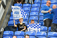 Portsmouth fans wave promotion flags during the EFL Sky Bet League 2 match between Portsmouth and Cambridge United at Fratton Park, Portsmouth, England on 22 April 2017. Photo by Adam Rivers.