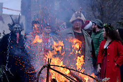 People in costume gather around a bonfire during the eight annual Parade of Spirits Krampus Parade through the Northern Liberties neighborhood of Philadelphia, PA on December 15, 2018.  Krampus hails from European traditions like the controversial Zwarte Piet (Black Pete) from the Netherlands and similar characters who — in folklore of various European cultures —  go after misbehaved children.