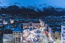 THEMENBILD - das Befreiungsdenkmal am Eduard-Wallnöfer-Platz (vormals Landhausplatz) mit den Lichtern der Stadt und den Berge der Nordkette, aufgenommen am 23. Jänner 2021 in Innsbruck, Oesterreich // the Liberation Monument at Eduard-Wallnöfer-Platz (formerly Landhausplatz) with the lights of the city and the mountains of the Nordkette in Innsbruck, Austria on 2021/01/23. EXPA Pictures © 2021, PhotoCredit: EXPA/ JFK