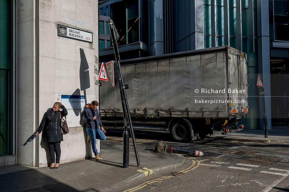 A street corner where a damaged bollard lies horizontal, knocked over by a vehicle on 13th February 2017, in the City of London, United Kingdom.