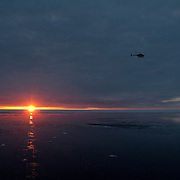 A helicopter brings back the polar bear capture team to the icebreaker Polar Sea. Arctic Ocean