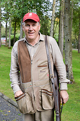 Sir Edward Dashwood at Young Guns raising money for the fight against breast cancer trough Cancer Research UK held at EJ Churchill Shooting School followed by lunch at West Wycombe Park, England. 23 September 2017.
