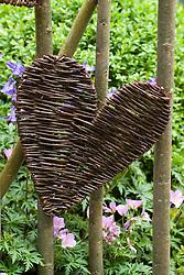 Detail of heart shaped woven panel set into gate. The Cumbrian Fellside Garden. Design: Kim Wilde and Richard Lucas - Chelsea 2005