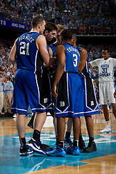 CHAPEL HILL, NC - MARCH 05: Miles Plumlee #21 and Tyler Thornton #3 of the Duke Blue Devils huddle while playing the North Carolina Tar Heels on March 05, 2011 at the Dean E. Smith Center in Chapel Hill, North Carolina. North Carolina won 67-81. (Photo by Peyton Williams/UNC/Getty Images) *** Local Caption *** Miles Plumlee;Tyler Thornton