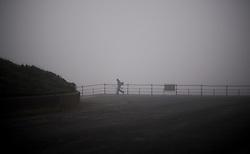 © Licensed to London News Pictures. 21/11/2011..Saltburn, England ..A Lone fisherman walks through the fog on Saltburn beach to go sea fishing...Photo credit : Ian Forsyth/LNP