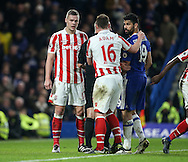 Chelsea's Diego Costa tussles with Stoke's Ryan Shawcross during the Premier League match at Stamford Bridge Stadium, London. Picture date December 31st, 2016 Pic David Klein/Sportimage
