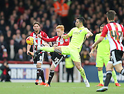 Brentford midfielder Ryan Woods and Brighton central midfielder, Beram Kayal (7) compete during the Sky Bet Championship match between Brentford and Brighton and Hove Albion at Griffin Park, London, England on 26 December 2015.