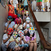 Girls at the Laura Vicuña residential centre in Querzon City, Manila. They have all been exposed to abuse and now live at the centre where they receive care and attention and counselling. They all wear masks made in art therapy to protect their identity.  Laura Vicuña is a non-profit charity working in Manila and in Bacolod in the state Negros Occidental in the Philippines.