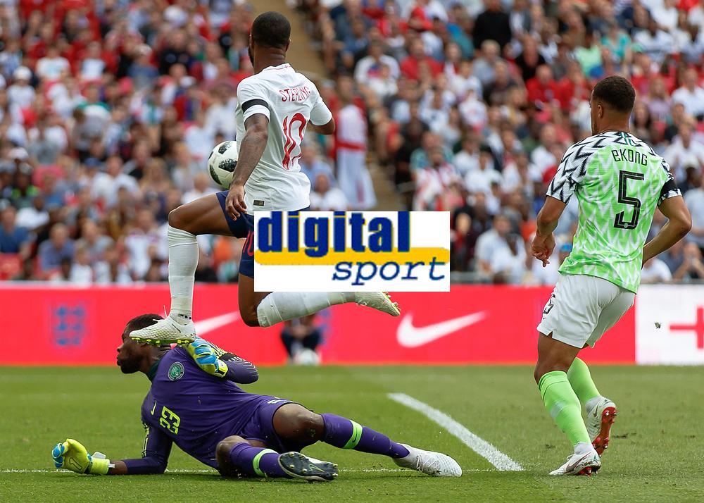 Football - 2018 International Friendly (pre-World Cup warm-up) - England vs. Nigeria<br /> <br /> Francis Uzoho (Nigeria) spreads himself to prevent Raheem Sterling (England) at Wembley Stadium.<br /> <br /> COLORSPORT/DANIEL BEARHAM