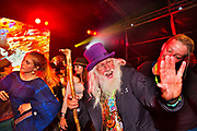 Glastonbury Festival, 2015. Shangri La is a festival of contemporary performing arts held each year within Glastonbury Festival. The theme for the 2015 Shangri La was Protest. Old hippy with wizard stick dancing on the Hell stage.