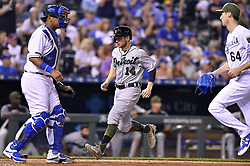 May 29, 2017 - Kansas City, MO, USA - Detroit Tigers' Alex Presley scores between Kansas City Royals catcher Salvador Perez and relief pitcher Matt Strahm on a two-run single by Miguel Cabrera in the eighth inning on Monday, May 29, 2017 at Kauffman Stadium in Kansas City, Mo. (Credit Image: © John Sleezer/TNS via ZUMA Wire)