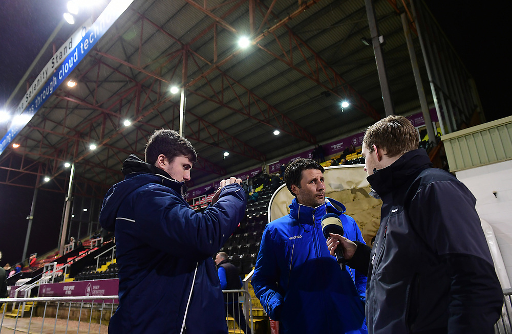 Lincoln City manager Danny Cowley is interviewed during the pre-match warm-up<br /> <br /> Photographer Chris Vaughan/CameraSport<br /> <br /> The EFL Sky Bet League Two - Lincoln City v Cheltenham Town - Tuesday 13th February 2018 - Sincil Bank - Lincoln<br /> <br /> World Copyright © 2018 CameraSport. All rights reserved. 43 Linden Ave. Countesthorpe. Leicester. England. LE8 5PG - Tel: +44 (0) 116 277 4147 - admin@camerasport.com - www.camerasport.com