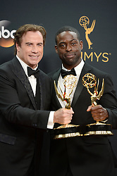 John Travolta and Sterling K. Brown pose in the press room during the 68th Annual Primetime Emmy Awards at Microsoft Theater on September 18, 2016 in Los Angeles, CA, USA. Photo by Lionel Hahn/ABACAPRESS.COM