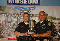 Chief Matt Canfield Laconia Police Dept and Chief Mark Armaganian NH State Liquor Commission were the joint recipients of the Fritzie Baer Award awarded at the 2019 kickoff event for the 96th Laconia Motorcycle Week at North East Motor Sports Museum in Loudon.  (Karen Bobotas/for the Laconia Daily Sun)