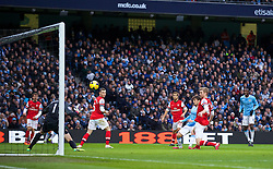 14.12.2013, Etihad Stadium, Manchester, ENG, Premier League, Manchester City vs FC Arsenal, 16. Runde, im Bild Manchester City's David Silva scores the fourth goal against Arsenal // during the English Premier League 16th round match between Manchester City and Arsenal FC at the Etihad Stadium in Manchester, Great Britain on 2013/12/14. EXPA Pictures © 2013, PhotoCredit: EXPA/ Propagandaphoto/ David Rawcliffe<br /> <br /> *****ATTENTION - OUT of ENG, GBR*****
