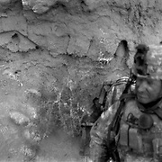 Jun 30, 2009 - Siah Choy, Kandahar Province, Afghanistan - US infantry  take cover behind a mud wall on the third of three days of fighting in the Siah Choy area of Zhari District in Kandahar Province, Afghanistan. Zhari District (aka Zharey) located west of Kandahar City has long been an insurgent stronghold and the birthplace of the Taliban movement lead by MULLAH MOHAMMAD OMAR in the 1990's..(Credit Image: © Louie Palu/ZUMA Press)