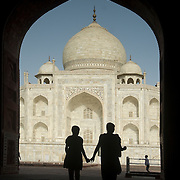 Unique image of Taj Mahal with silhouetted Indian mother and daughter
