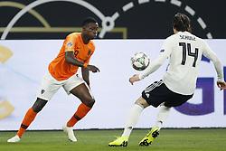 (L-R) Quincy Promes of Holland, Nico Schulz of Germany during the UEFA Nations League A group 1 qualifying match between Germany and The Netherlands at the Veltins Arena on November 19, 2018 in Gelsenkirchen, Germany