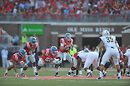 Mississippi Rebels offensive lineman Sean Rawlings (50) and Mississippi Rebels quarterback Chad Kelly (10) against Vanderbilt at Vaught-Hemingway Stadium at Ole Miss in Oxford, Miss. on Saturday, September 26, 2015. (AP Photo/Oxford Eagle, Bruce Newman)