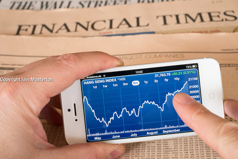 Detail of iPhone 5 smart phone screen showing financial app with stock market data