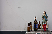 In a quirky scene of religious morality and a Christian lifestyle, a figure of Jesus stands surrounded by the bottles of an alcoholic night for others, on 18th July, at Aveira, Portugal. The World Health Organisation has called on governments to do more to prevent alcohol-related deaths and diseases as it released its Global Status Report on Alcohol and Health 2014 earlier this week, which found alcohol consumption in Portugal is still above the European average. 18 is the legal age for the purchase of alcohol in Portugal.