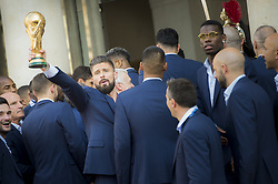Olivier Giroud holds the trophy during a reception at the Elysee Presidential Palace on July 16, 2018 in Paris, France, after French players won the Russia 2018 World Cup final football match. France celebrated their second World Cup win 20 years after their maiden triumph on July 15, 2018, overcoming a passionate Croatia side 4-2 in one of the most gripping finals in recent history. Photo by Eliot Blondet/ABACAPRESS.COM