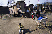 Slovak Roma living in all sorts of makeshift homes from old railway carriages to squats made from materials found in the rubbish dumps next to the cities. Slivinia, Slovakia.